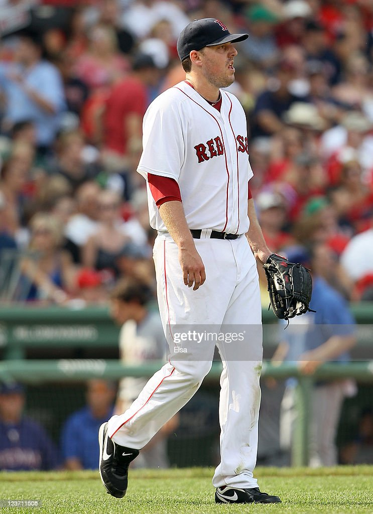 John Lackey #41 of the Boston Red Sox reacts just before he is pulled from the game against the Texas Rangers on September 4, 2011 at Fenway Park in Boston, Massachusetts.
