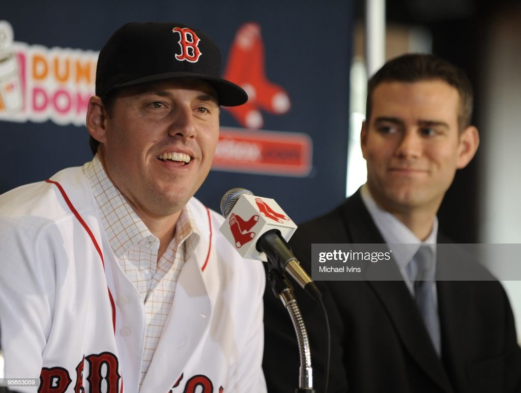 John Lackey of the Boston Red Sox speaks as general manager Theo Epstein (right) smiles during a press conference introducing Lackey as a member of the Red Sox at Fenway Park on Wednesday, December 16, 2009 in Boston, Massachusetts.