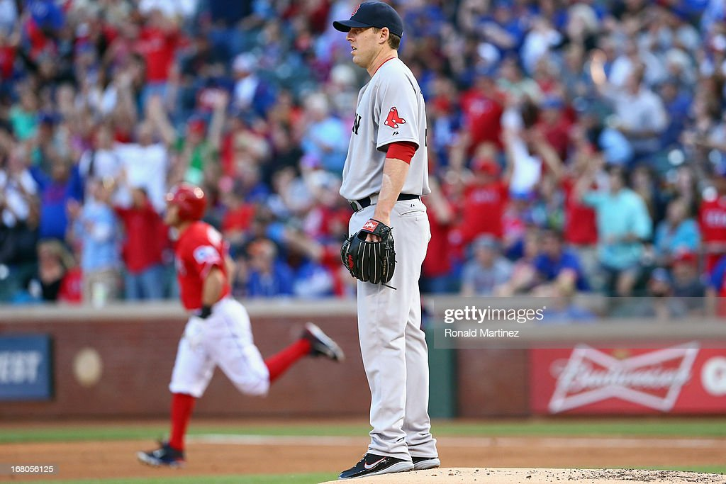 John Lackey #41 of the Boston Red Sox steps off the mound after giving up a solo homerun against Ian Kinsler #5 of the Texas Rangers at Rangers Ballpark in Arlington on May 4, 2013 in Arlington, Texas.