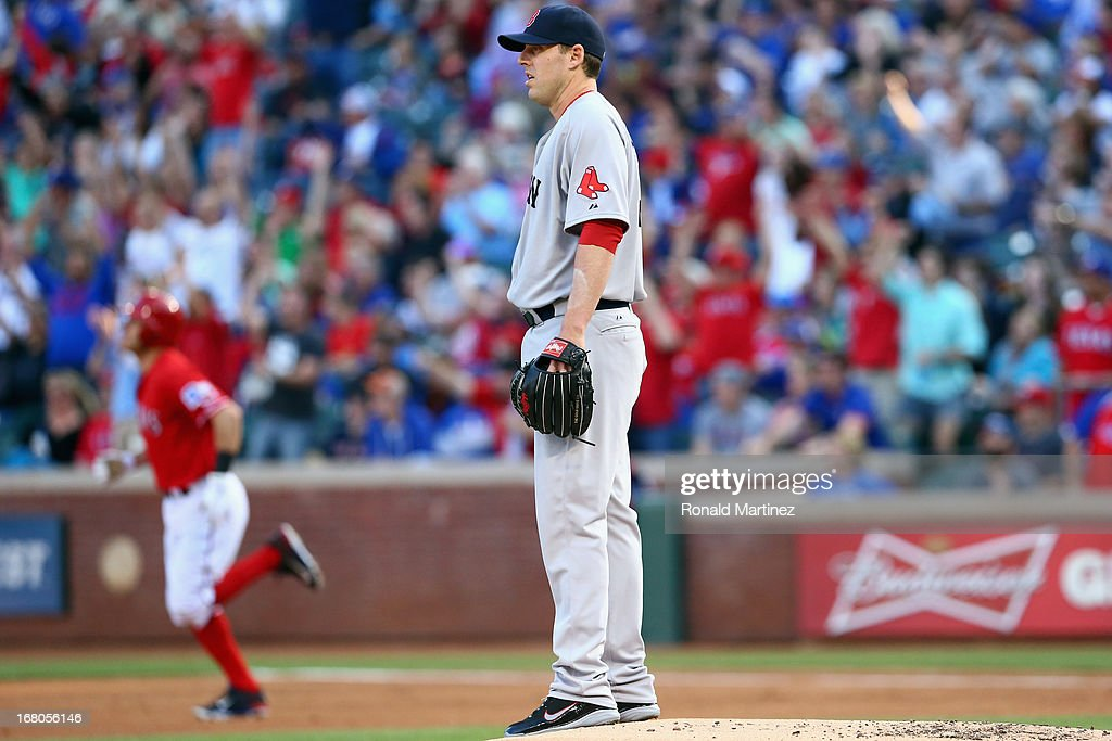 <a gi-track='captionPersonalityLinkClicked' href=/galleries/search?phrase=John+Lackey&family=editorial&specificpeople=171533 ng-click='$event.stopPropagation()'>John Lackey</a> #41 of the Boston Red Sox steps off the mound after giving up a solo homerun against Ian Kinsler #5 of the Texas Rangers at Rangers Ballpark in Arlington on May 4, 2013 in Arlington, Texas.