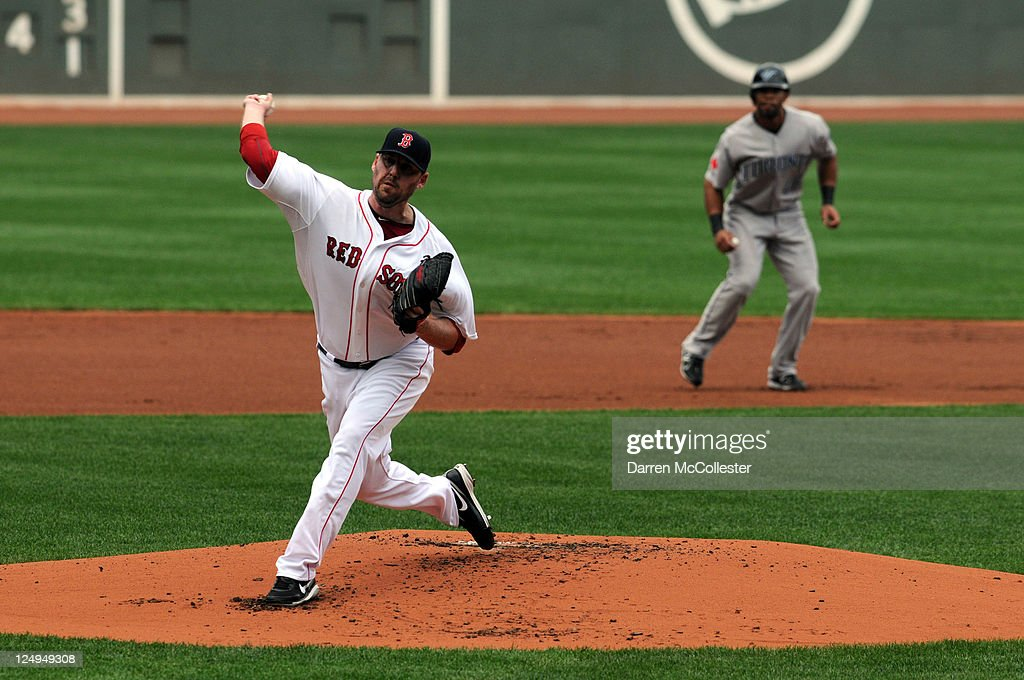 <a gi-track='captionPersonalityLinkClicked' href=/galleries/search?phrase=John+Lackey&family=editorial&specificpeople=171533 ng-click='$event.stopPropagation()'>John Lackey</a> #41 of the Boston Red Sox throws a pitch in the first inning against the Toronto Blue Jays at Fenway Park on September 14, 2011 in Boston, Massachusetts.