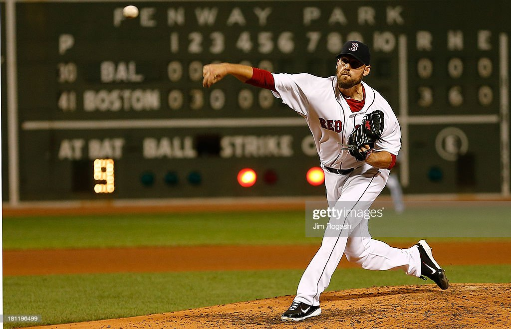 <a gi-track='captionPersonalityLinkClicked' href=/galleries/search?phrase=John+Lackey&family=editorial&specificpeople=171533 ng-click='$event.stopPropagation()'>John Lackey</a> #41 of the Boston Red Sox throws against the Baltimore Orioles in the 6th inning at Fenway Park on September 19, 2013 in Boston, Massachusetts.