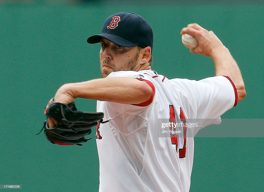 John Lackey #41 of the Boston Red Sox throws against the Colorado Rockies at Fenway Park on June 26, 2013 in Boston, Massachusetts.