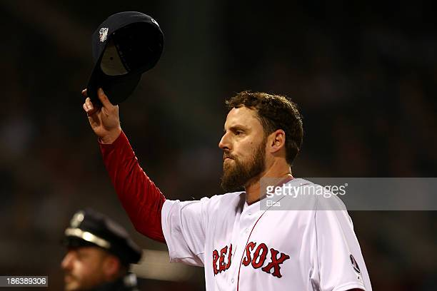 John Lackey of the Boston Red Sox tips his cap after being pulled in the seventh inning against the St Louis Cardinals during Game Six of the 2013...