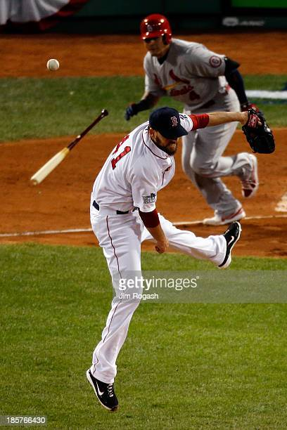 John Lackey of the Boston Red Sox tries to field a ball hit by Yadier Molina of the St Louis Cardinals during Game Two of the 2013 World Series at...