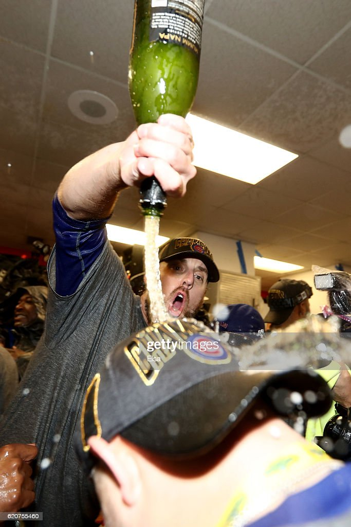 John Lackey #41 of the Chicago Cubs celebrates with teammates in the clubhouse after the Cubs defeated the Cleveland Indians 8-7 in Game Seven of the 2016 World Series at Progressive Field on November 2, 2016 in Cleveland, Ohio. The Cubs win their first World Series in 108 years.