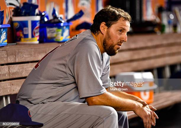 John Lackey of the Chicago Cubs rests in the dugout in the second inning during the game between the Miami Marlins and the Chicago Cubs at Marlins...
