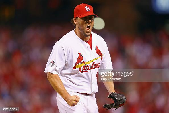 John Lackey of the St Louis Cardinals celebrates after a double play in the seventh inning against the Chicago Cubs during game one of the National...