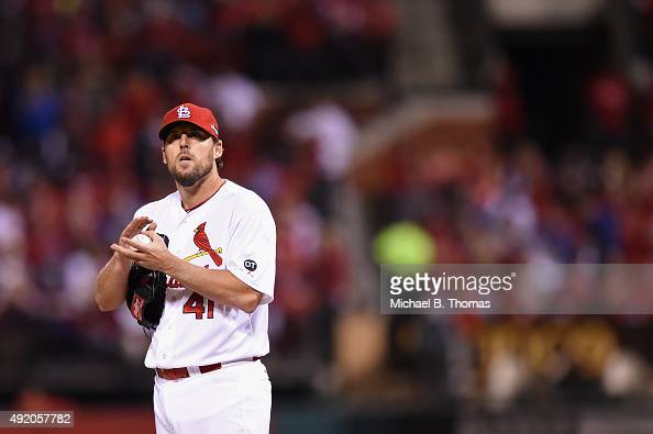 John Lackey of the St Louis Cardinals looks on between pitches in the sixth inning against the Chicago Cubs during game one of the National League...