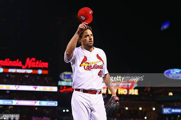 John Lackey of the St Louis Cardinals tips his hat to fans as he walks off the field in the eighth inning against the Chicago Cubs during game one of...