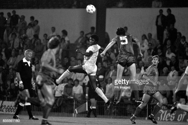 John Lacy of Crystal Palace beats Peterborough's Ian Benjamin in the air to get to the ball first during the First Round Milk Cup match at Selhurst...