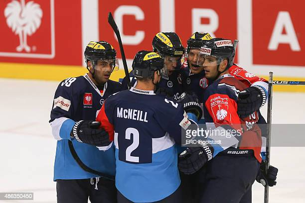 John Laliberte of ERC Ingolstadt celebrates with teammates after scoring the 32 during the Champions Hockey League group stage game between ERC...