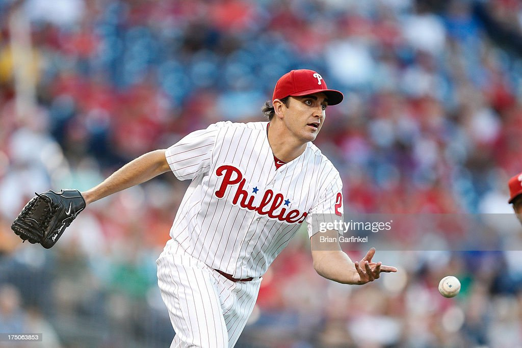 <a gi-track='captionPersonalityLinkClicked' href=/galleries/search?phrase=John+Lannan&family=editorial&specificpeople=4432497 ng-click='$event.stopPropagation()'>John Lannan</a> #27 of the Philadelphia Phillies fields a Marco Scutaro #19 of the San Francisco Giants bunt in the first inning of the game at Citizens Bank Park on July 30, 2013 in Philadelphia, Pennsylvania.