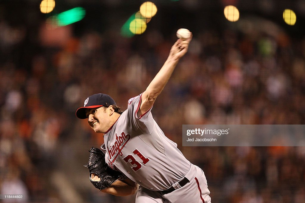 <a gi-track='captionPersonalityLinkClicked' href=/galleries/search?phrase=John+Lannan&family=editorial&specificpeople=4432497 ng-click='$event.stopPropagation()'>John Lannan</a> #31 of the Washington Nationals pitches against the San Francisco Giants during an MLB game at AT&T Park on June 6, 2011 in San Francisco, California.