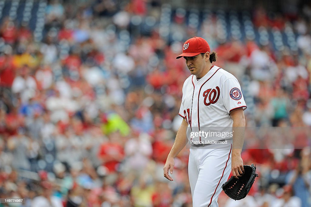 <a gi-track='captionPersonalityLinkClicked' href=/galleries/search?phrase=John+Lannan&family=editorial&specificpeople=4432497 ng-click='$event.stopPropagation()'>John Lannan</a> #31 of the Washington Nationals walks off the field after being pulled from the game in the seventh inning against the Miami Marlins at Nationals Park on August 3, 2012 in Washington, DC.