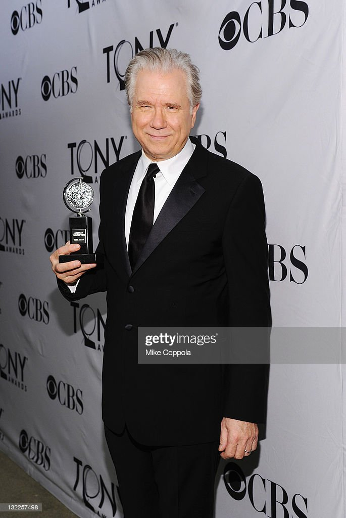 John Larroquette poses with the award for Best Performance by an Actor in a Featured Role in a Musical during the 65th Annual Tony Awards at the The Jewish Community Center in Manhattan on June 12, 2011 in New York City.