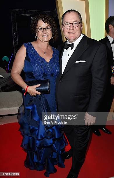 John Lasseter and wife Nancy attend the 'Inside Out' party during the 68th annual Cannes Film Festival on May 18 2015 in Cannes France