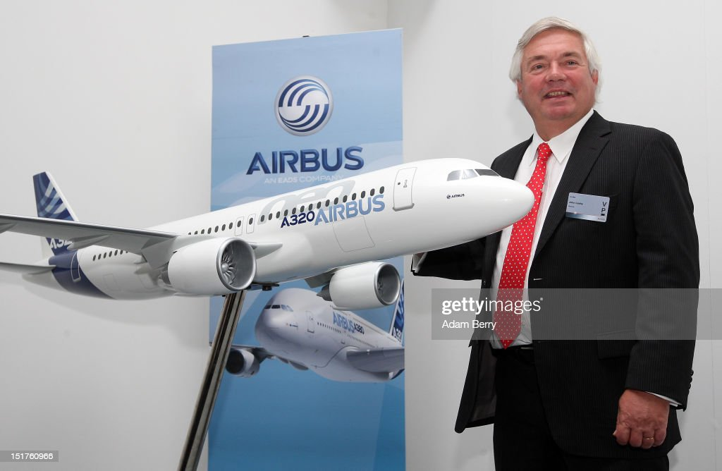 John Leahy chief commercial officer of Airbus poses with a model of an Airbus A320 airplane during the company's press conference at the 2012...