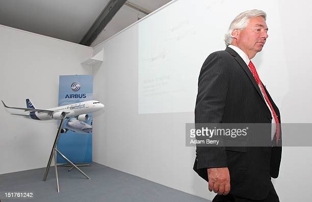 John Leahy chief commercial officer of Airbus walks away from a model of an Airbus A320 airplane during the company's press conference at the 2012...