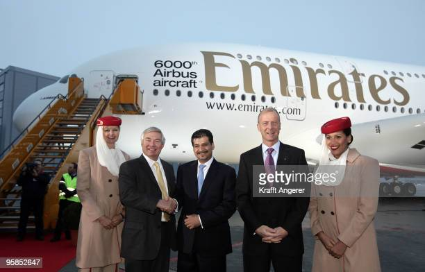 John Leahy Chief Operating Officer Airbus Adel Al Redha Executive Vice President Emirates Engineering and Operations and Tom Enders Airbus CEO pose...
