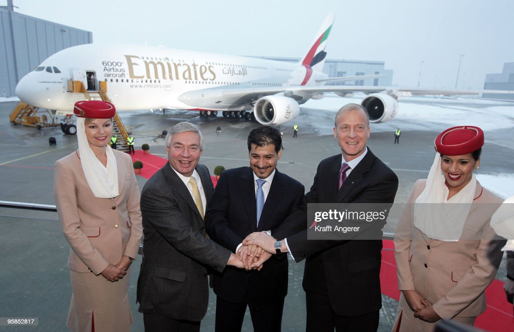 John Leahy, Chief Operating Officer Airbus, Adel Al Redha, Executive Vice President Emirates Engineering and Operations and Tom Enders, Airbus CEO, shake hands in front of the aircraft during the hand over of the A380 to the Emirates airline on January 18, 2010 in Hamburg, Germany.The world's largest passenger liner, built by the European aircraft manufacturer Airbus, is delivered to the Fly Emirates airline.