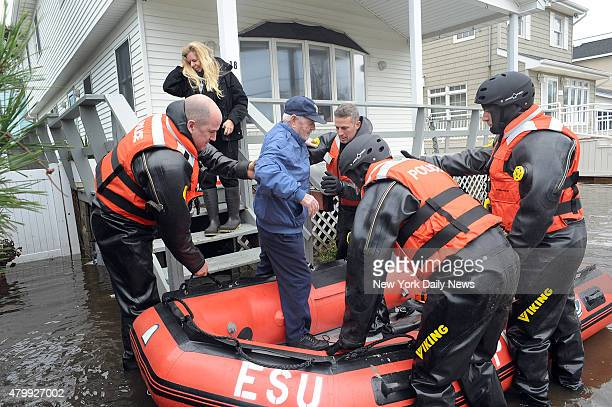 John Lee is put into a dingy by police to evacuate Breezy Point which suffered severe damage by Hurricane SandyTuesday October 30 2012 Queens NY
