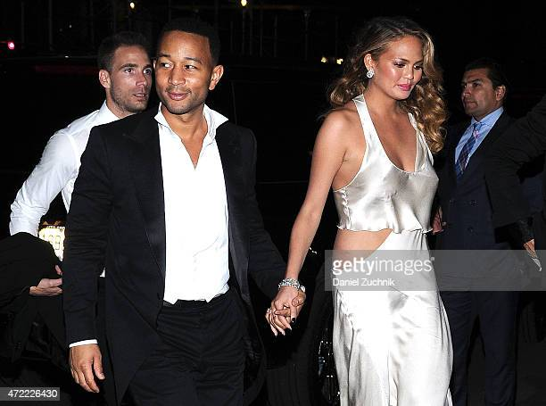 John Legend and Chrissy Teigan arrive at Rihanna's Private Met Gala After Party at Up Down on May 4 2015 in New York City