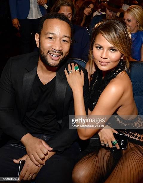 John Legend and Chrissy Teigen attend the 2015 MTV Video Music Awards at Microsoft Theater on August 30 2015 in Los Angeles California