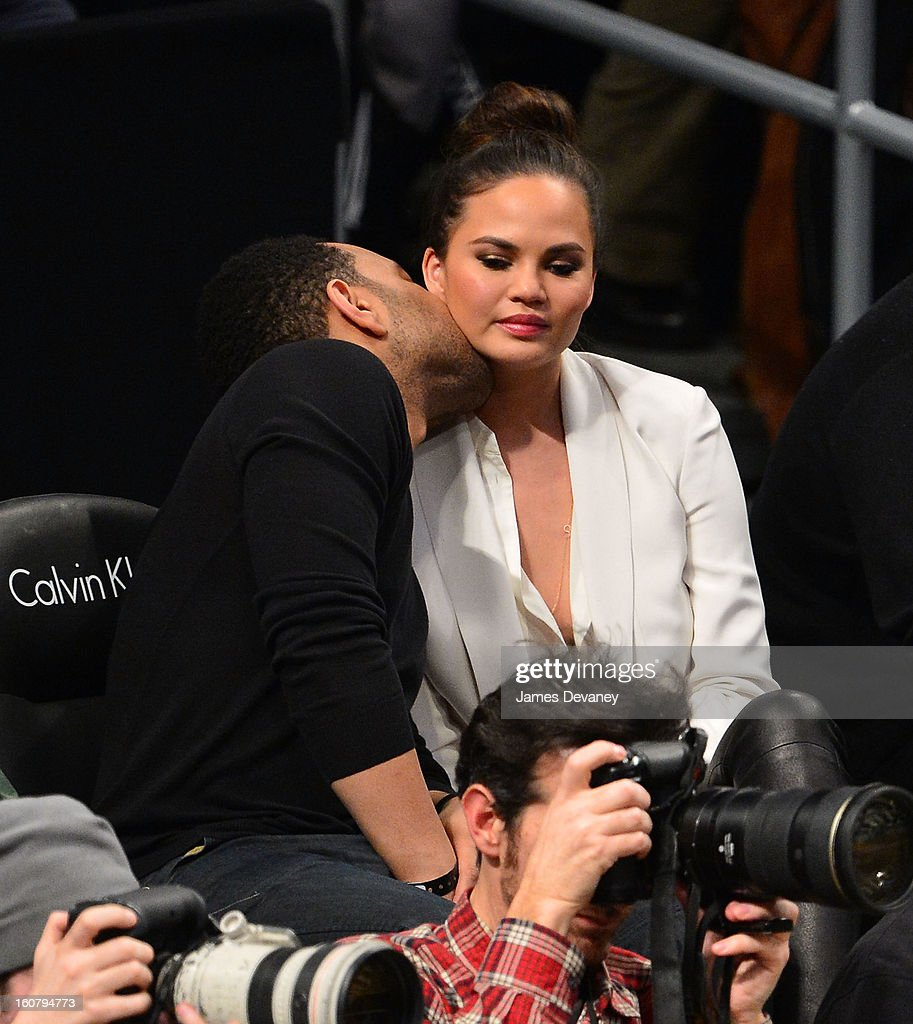 <a gi-track='captionPersonalityLinkClicked' href=/galleries/search?phrase=John+Legend&family=editorial&specificpeople=201468 ng-click='$event.stopPropagation()'>John Legend</a> and Chrissy Teigen attend the Los Angeles Lakers vs Brooklyn Nets game at Barclays Center on February 5, 2013 in the Brooklyn borough of New York City.