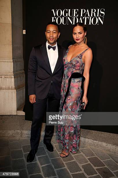 John Legend and Chrissy Teigen attend theVogue Paris Foundation Gala at Palais Galliera on July 6 2015 in Paris France