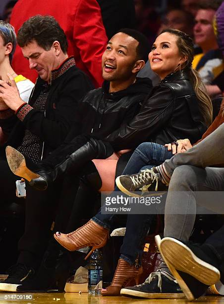 John Legend and Chrissy Teigen watch the game between the Cleveland Cavaliers and the Los Angeles Lakers at Staples Center on March 10 2016 in Los...