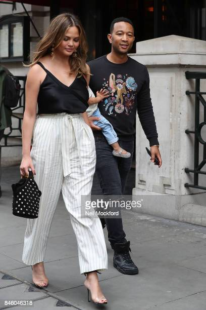 John Legend and Chrissy Teigen with their daughter Luna seen heading out to lunch at Balthazar in Covent Garden on September 12 2017 in London England