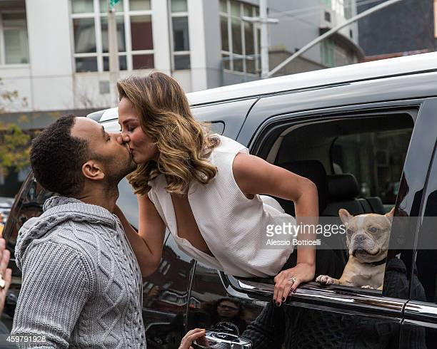 John Legend and Chrissy Teigen with their dog are seen during a photo shoot in East Village on December 1 2014 in New York City