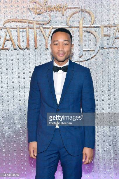 John Legend arrives at the world premiere of Disney's new liveaction 'Beauty and the Beast' photographed in front of the Swarovski crystal wall at...
