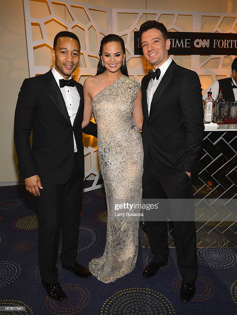 <a gi-track='captionPersonalityLinkClicked' href=/galleries/search?phrase=John+Legend&family=editorial&specificpeople=201468 ng-click='$event.stopPropagation()'>John Legend</a>, Chrissy Teigen and <a gi-track='captionPersonalityLinkClicked' href=/galleries/search?phrase=JC+Chasez&family=editorial&specificpeople=209140 ng-click='$event.stopPropagation()'>JC Chasez</a> attend the TIME/CNN/PEOPLE/FORTUNE Pre-Dinner Cocktail Reception at Washington Hilton on April 27, 2013 in Washington, DC.