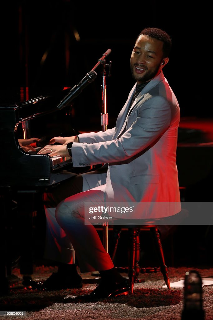 John Legend performs at The Greek Theatre on August 18, 2014 in Los Angeles, California.