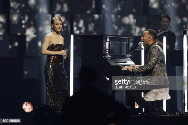 John Legend performs on stage at the piano that once was damaged in the 1945 atomic bombing of Hiroshima during the Nobel Peace Prize Concert to...