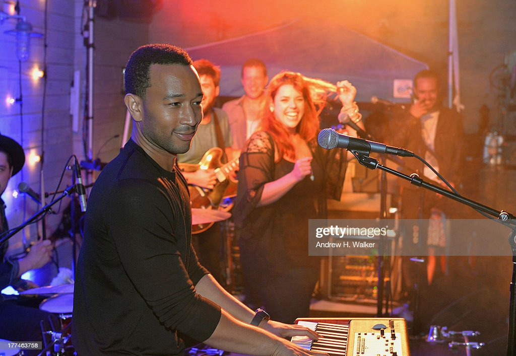 <a gi-track='captionPersonalityLinkClicked' href=/galleries/search?phrase=John+Legend&family=editorial&specificpeople=201468 ng-click='$event.stopPropagation()'>John Legend</a> performs with Mumford & Sons live at Soho House New York's 10th Birthday Celebration on August 22, 2013 in New York City.