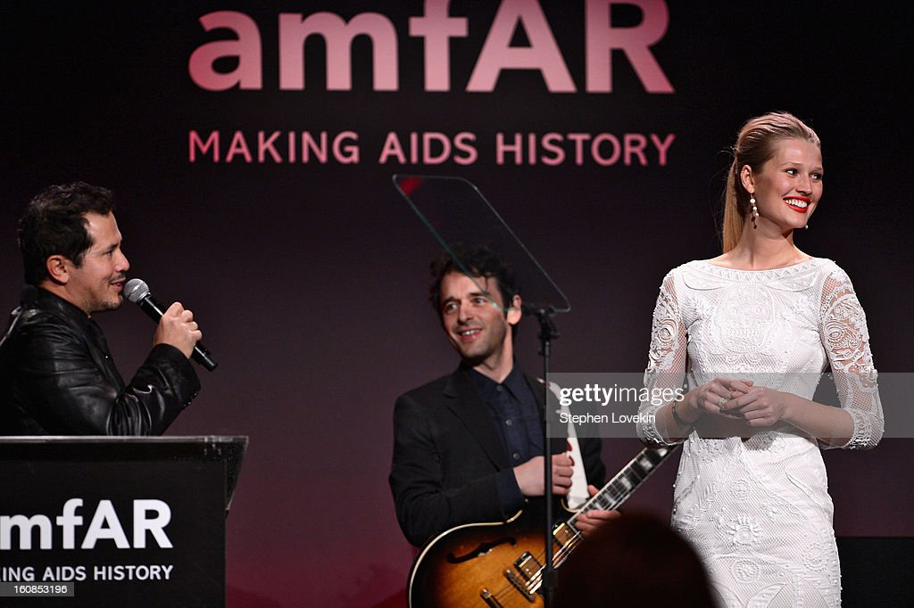 John Leguizamo and Toni Garrn speak onstage at the amfAR New York Gala to kick off Fall 2013 Fashion Week at Cipriani Wall Street on February 6, 2013 in New York City.