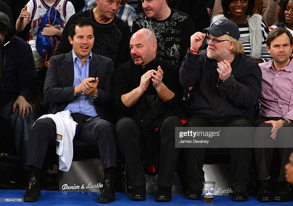 John Leguizamo guest and Philip Seymour Hoffman attend the Utah Jazz vs New York Knicks game at Madison Square Garden on March 9 2013 in New York City
