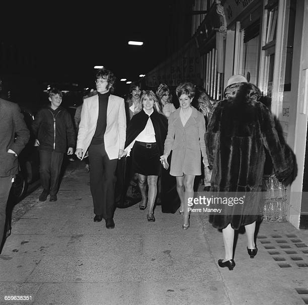 John Lennon and his wife Cynthia arriving at the launch party for the Apple boutique run by the Beatles' Apple Corps on Baker Street London 5th...