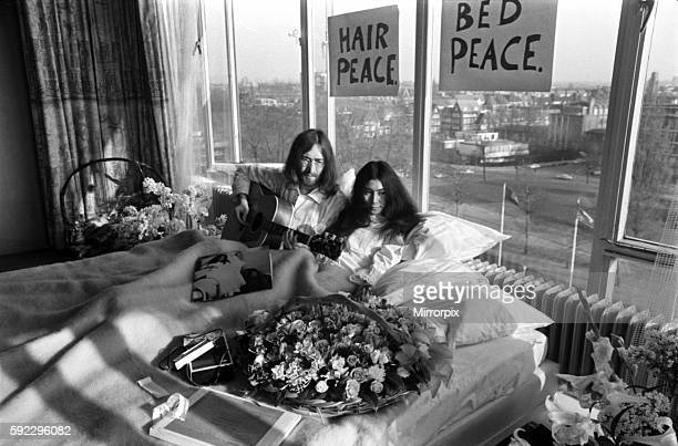 John Lennon and his wife Yoko Ono are having a weeks lovein their room at the Hilton Hotel Amsterdam They will stay in bed for seven days with fruit...