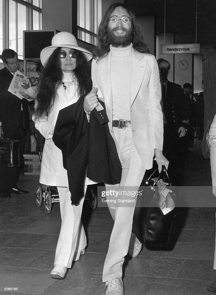 John lennon 1940 1980 and his wife yoko ono arrive at london