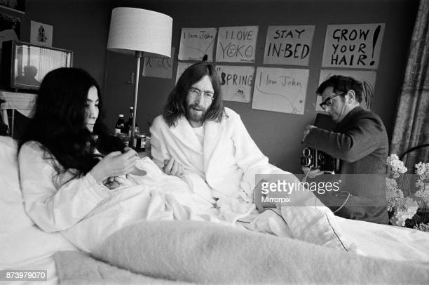 John Lennon and his wife Yoko Ono stage a 'bed in' in a hotel in Amsterdam as a protest against war and violence in the world 26th March 1969