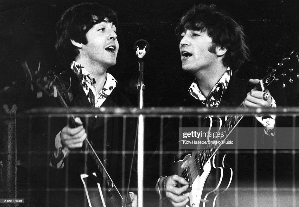 John Lennon and Paul McCartney of The Beatles share a microphone during the last concert on their final tour at Candlestick Park San Francisco...