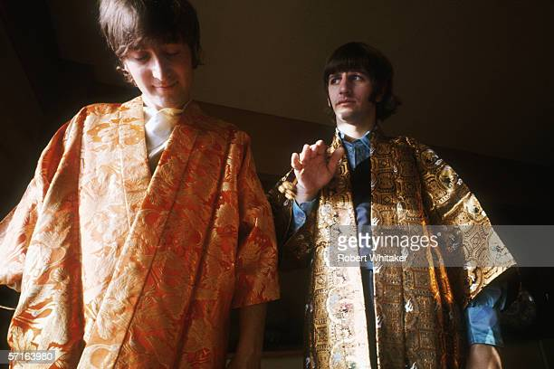 John Lennon and Ringo Starr try on a pair of gold embroidered kimonos in Tokyo during the Beatles' Asian tour 1966