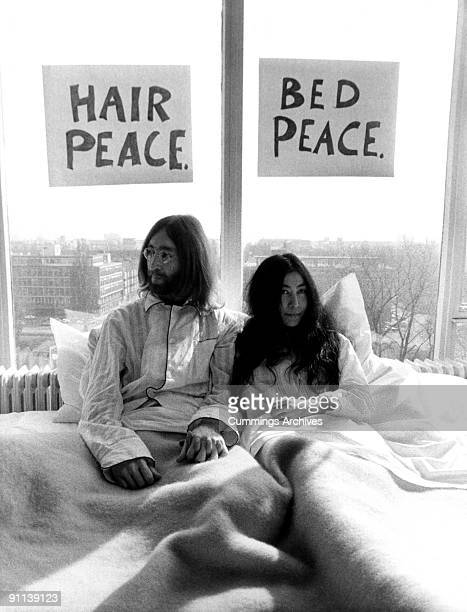 Photo of John LENNON and Yoko ONO while in The Beatles posed with Yoko Ono at the 'bedin' in the Presidential Suite of the Hilton hotel