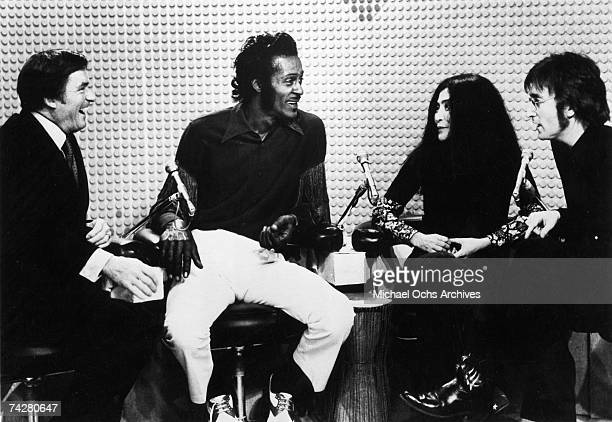 John Lennon and Yoko Ono cohost 'The Mike Douglas Show' with Mike Douglas and guest Chuck Berry in February 1972