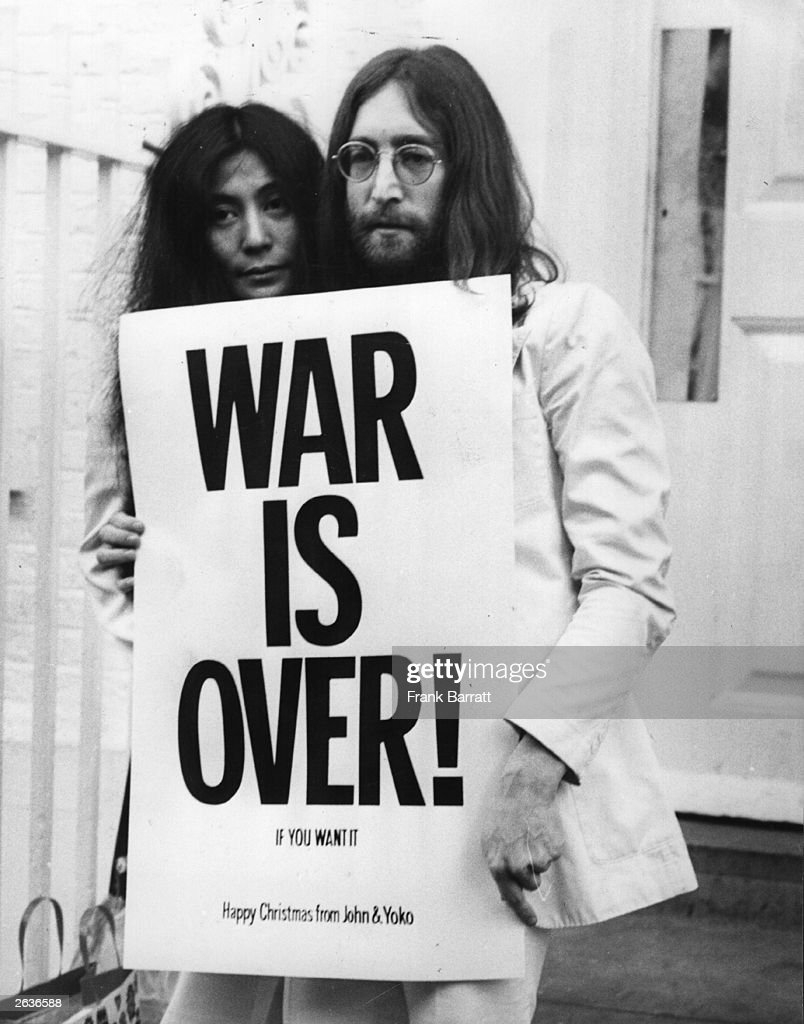 <a gi-track='captionPersonalityLinkClicked' href=/galleries/search?phrase=John+Lennon&family=editorial&specificpeople=91242 ng-click='$event.stopPropagation()'>John Lennon</a> (1940 - 1980) and <a gi-track='captionPersonalityLinkClicked' href=/galleries/search?phrase=Yoko+Ono&family=editorial&specificpeople=202054 ng-click='$event.stopPropagation()'>Yoko Ono</a> pose on the steps of the Apple building in London, holding one of the posters that they distributed to the world's major cities as part of a peace campaign protesting against the Vietnam War. 'War Is Over, If You Want It'.