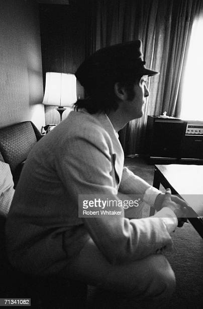 John Lennon enjoying a quiet moment in the Beatles' suite at the Tokyo Hilton 1966